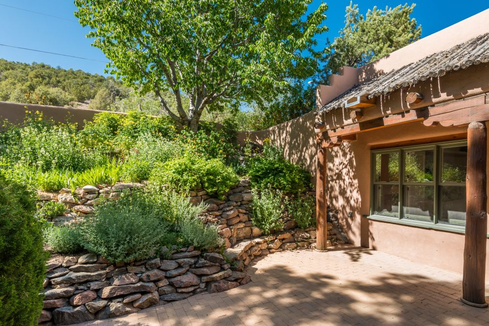 ... Private Patio Off Of Ownersu0027 Suite With Lush Landscaping And Rock Wall  Fountain ...