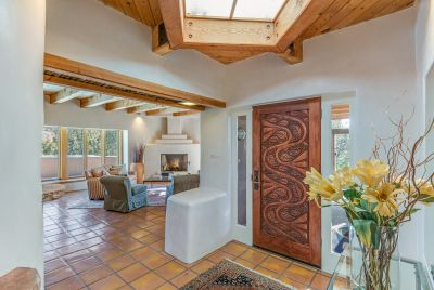 Entry Foyer with Elaborately Carved Door, Looking to Living Room