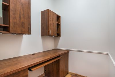 Office with Built-in Desk and Cabinets