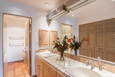 Owner's Bathroom with Wall of Closets