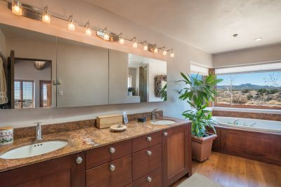 The Large Owners' Bathroom has Magnificent Views of the Sangre de Cristo Mountains