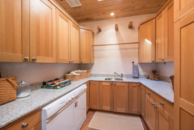 The Large Laundry Room with Ample Cabinetry Also Serves as a Craft Room or Office