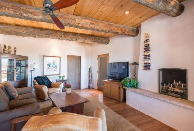 Family Room with Wood-burning Fireplace and Access to the Entertainment Portal