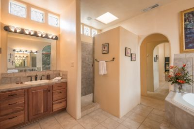 Owners' Bathroom with Walk-in Shower and Double Walk-in Closets