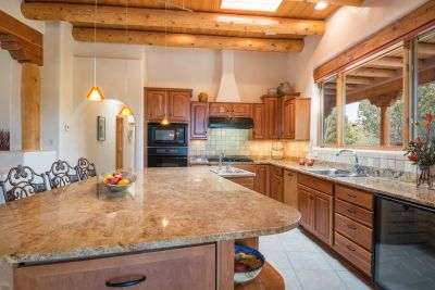 Gourmet Kitchen has High-end Appliances and Large Breakfast Island