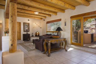 Family Room Area with Raised Kiva Fireplace and Access to Entertainment Portal and Patio
