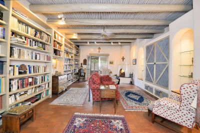 Here is a wonderful library, study with a kiva fireplace and doors to the outside...a wonderful place to relax with a good book!