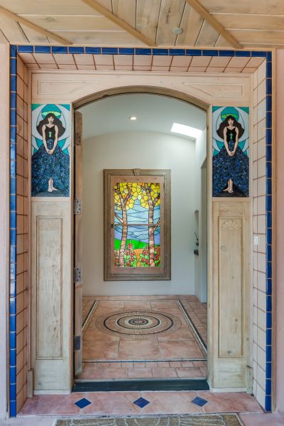 Front door is flanked by handmade art stained glass.