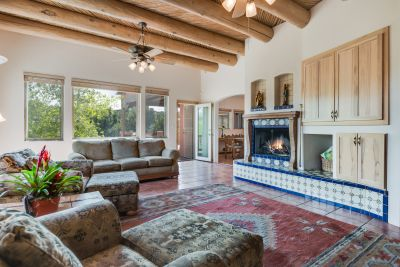 Great room has high ceilings with vigas & latillas, views!, and a fireplace
