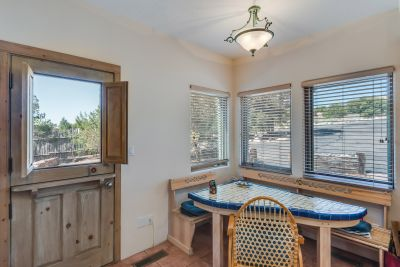 Breakfast nook in the kitchen with door to the outside.