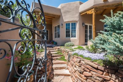Through the Custom Gate to the Walled Entry Courtyard with Professional Landscaping