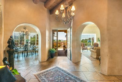 Elegant Archways in the Entry Foyer with 14-ft. Ceilings and Flagstone Floors