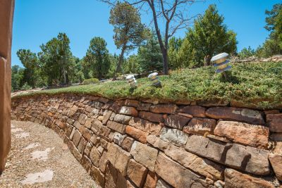 Handsome stone wall and flagstone path to the rear grounds.