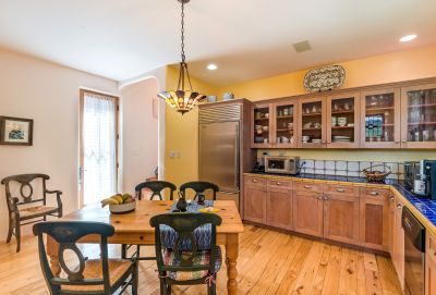 Kitchen - Subzero Refrigerator/freezer & dacor gas range. Walk-in pantry and glass door to a patio with dining portal.
