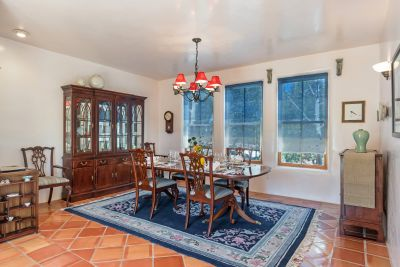 Spacious Dining Room - Saltillo tile floor and windows looking out to greenery.