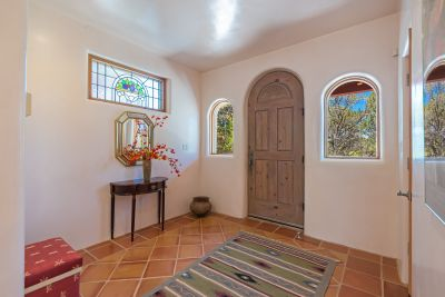 Formal Entry with saltillo tile floor & stained glass window.