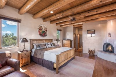 Bedroom in the Owners' Suite with Kiva Fireplace and Private Viewing Deck