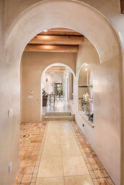 Entry Foyer Highlights the Archways and Polished Stone Tile Floors