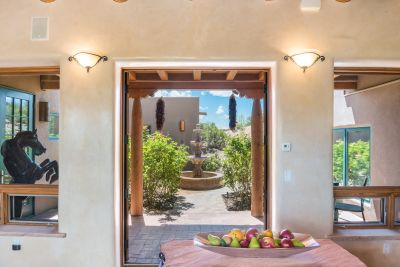 French Doors Open from the Living Room to the Entertainment Portal and Rose Garden