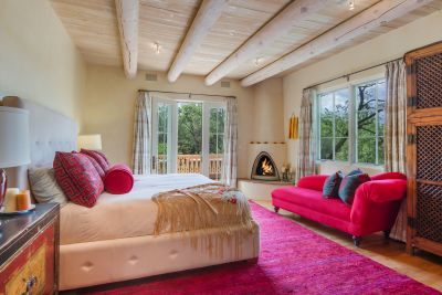 Owners' Bedroom with Kiva Fireplace and Private Deck
