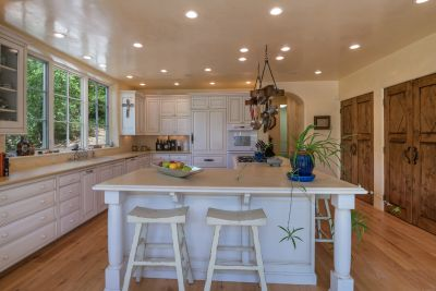 Gourmet Kitchen with Three Pantries and Island with Seating for Six