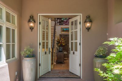 The Elegant Entry Features French Doors to the Foyer