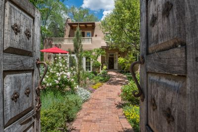 Antique Doors and Winding Brick Pathway to the Elegant Residence Entry