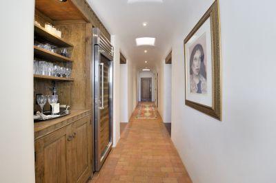 Hallway from Kitchen to Garage - Wine Cooler