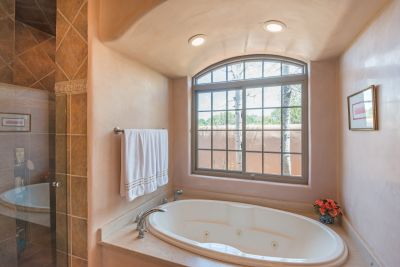 Jetted Tub and Separate Walk-in Shower in Owners' Suite Bathroom