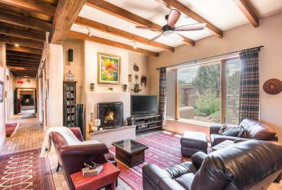 Family Room with Large Fireplace Overlooks the Entry Courtyard