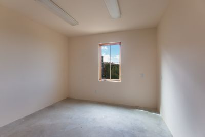 Large Bonus Room with Concrete Floor and Great Natural Light off of Garage