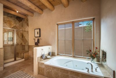 Jetted Tub and Walk-in Shower of Owners' Bathroom
