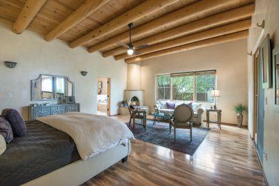 Expansive Bedroom of Owners' Suite Accesses Entertainment Portal