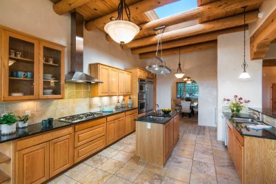 Chef's Kitchen with Skylight and Dining Room Beyond