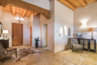 Entry Foyer with Closet and Access to Large Powder Room