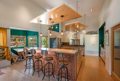 Gourmet Kitchen featuring lots of counter space, two sinks, cork floors and huge walk-in pantry
