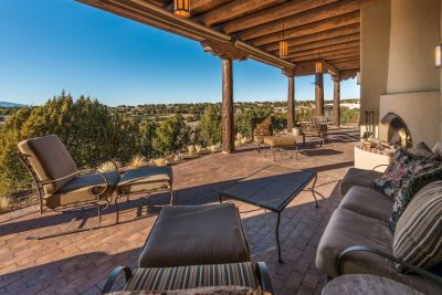 Expansive Back Portal off Living Room with Golf Course and Jemez Mountain Views