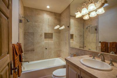 Bath # 2 with travertine tub/shower surround