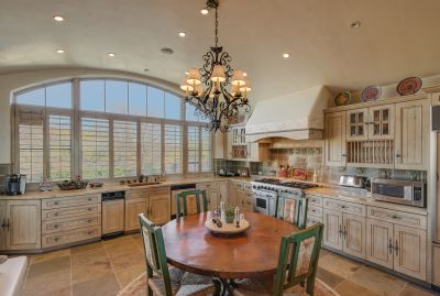 Gourmet Eat-in Kitchen with Professional Stainless Appliances and expansive windows