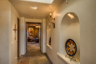 Hallway from Master to Bedroom 4 / Den, showing art nichos