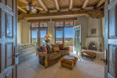Master Bedroom, showing Jemez view and Retreat with Fireplace and custom ceiling detail