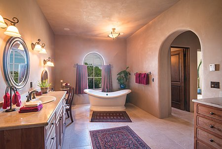Master Bathroom with freestanding tub and steam room.