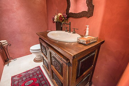 Powder Room located off of the den.