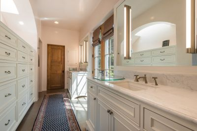 Abundant Cabinet Storage in the Owners' Bathroom, plus Two Walk-in Closets