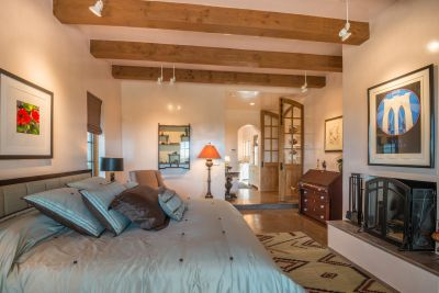 Owners' Bedroom with Fireplace and Private Portal Occupies a Separate Wing of the Home