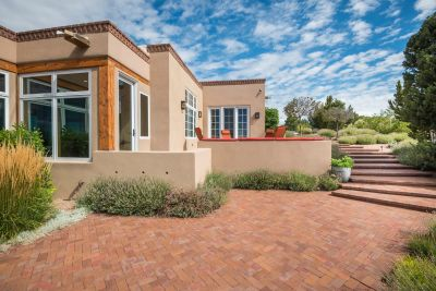 Brick Patios and Pathways Surround the Home