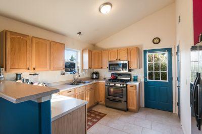 Spacious Kitchen with Door to Yard