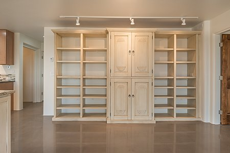 Built-in shelving and cabinetry in great room
