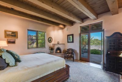 Owners' Bedroom with Kiva Fireplace and Private Portal