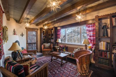 Cozy Reading Room off Master Suite with Kiva Fireplace and Access to Patios